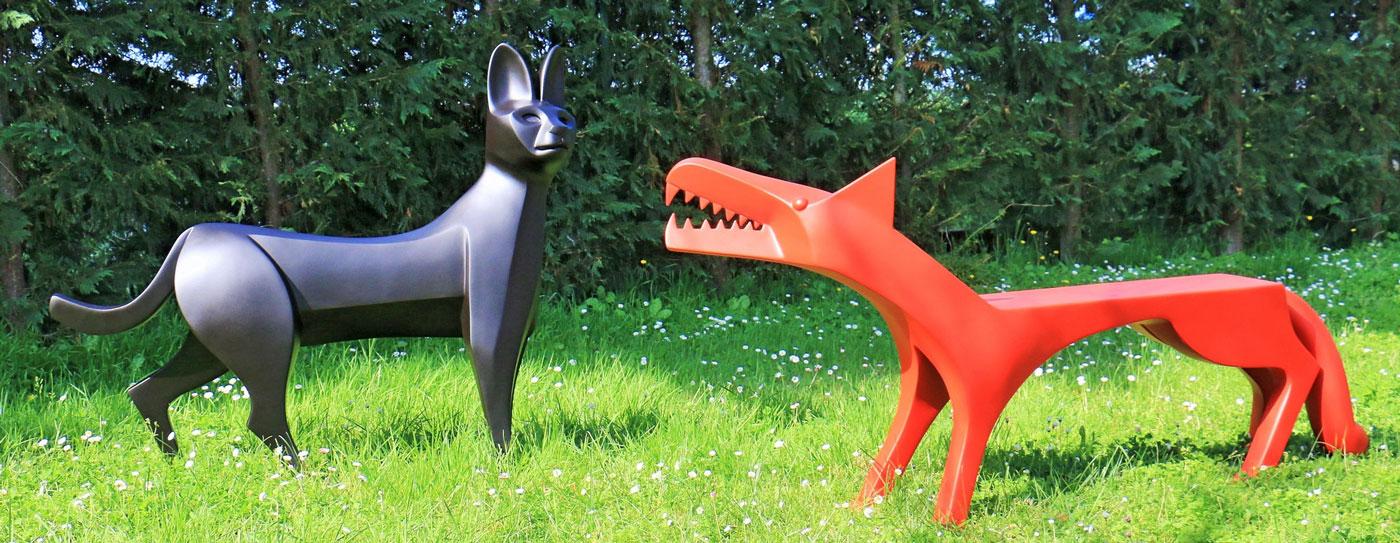 Serval et loup - Eric Valat